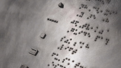 Braille signage with selective focus.