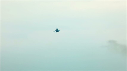 Fighter fly out in cloudy sky