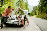 Travel - family with camping car on the road