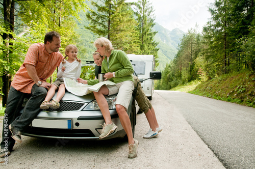Travel - family with camping car on the road - 38984579