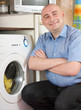middle-aged man doing laundry