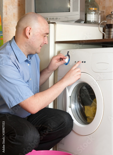 men loading the washing machine