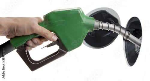 Male hand filling gas isolated on white