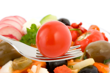 Cherry tomato on fork.