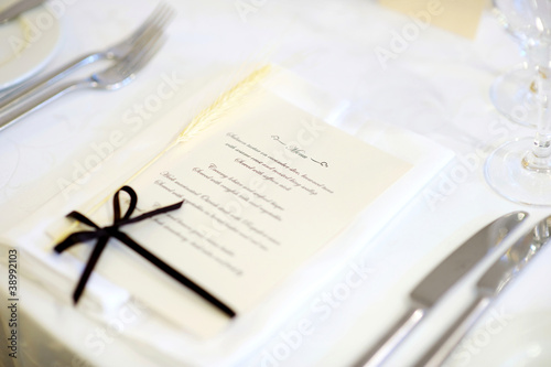 Table set with menu for an event party or wedding