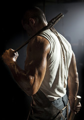 Muscular metal worker from behind