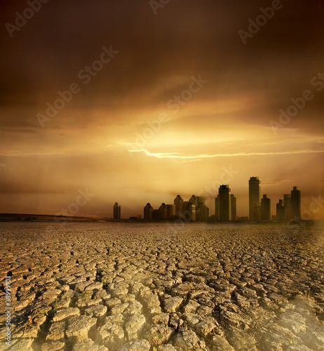 pollution theme with cracked land and the cityscape