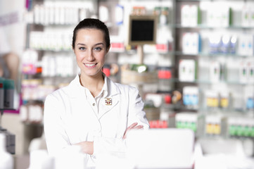 portrait of young healthcare worker and background pharmacy.