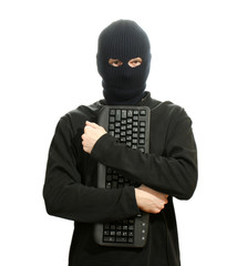 Hacker in black mask with keyboard isolated on white
