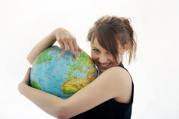 Junges Maedchen mit Globus