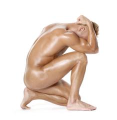 La anatomía musculosa de un hombre desnudo.