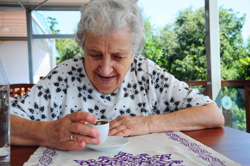 a senior fortune teller with coffee