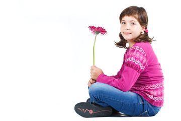 Cute girl sitting with flower