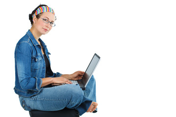 Happy woman sitting with laptop