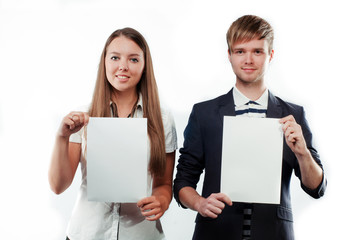 Attractive young man and woman holding two blank billboards with