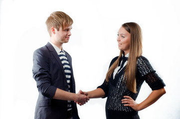 Beautiful young woman shaking hand to a business man isolated on