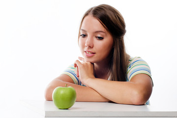 Portrait of a lovely young woman looking at fresh ripe apple iso