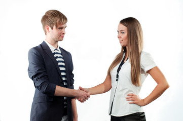 Young man and woman shaking hands  isolated on white background