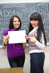Two students near the blackboard