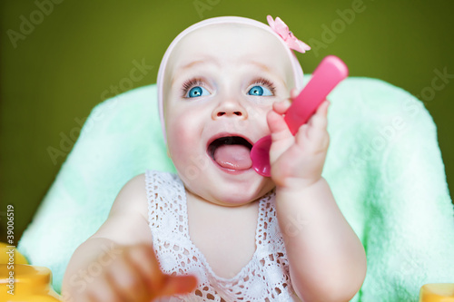cute kid with pink spoon