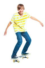 blond boy on standing on skateboard