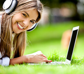 Happy woman downloading music