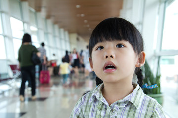 Little girl at the airport terminal