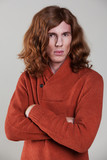 Young man with the long, auburn hair poster