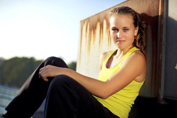 Parkour Girl Freerunner on Urban City Rooftop
