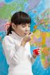 Постер, плакат: Девочка ест йогурт
