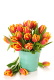 Beautiful bouquet of tulips in vase on white background.