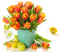 Beautiful bouquet of tulips in vase with Easter eggs on white ba