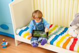 Kid playing with tablet pc