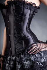 Close-up shot of elegant woman in black corset