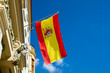 Spanish flag waving at an old building