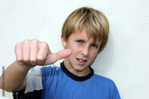 Child success by gesture with his hand