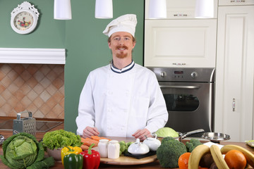 Young chef preparing lunch in kitchen