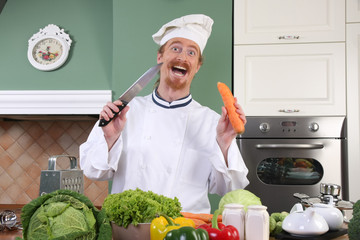 Funny young chef preparing lunch in kitchen