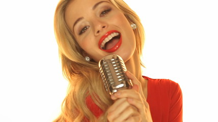 Woman In Red Dresss Holding Microphone