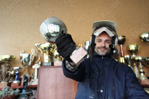 motorcyclist with trophy