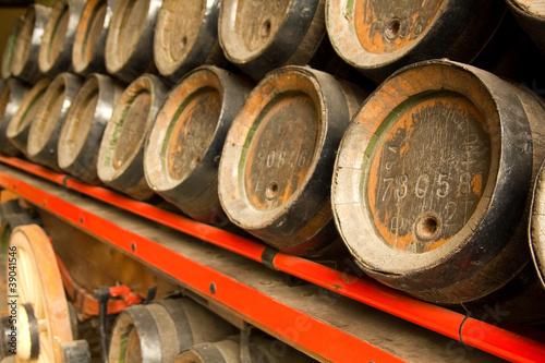Row of wooden beer barrels