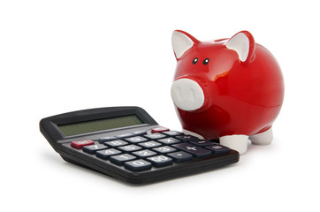 Calculator and piggy bank on white