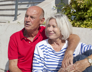 aging friends embracing each other