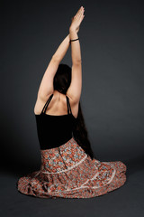 Hippie girl doing yoga exercise