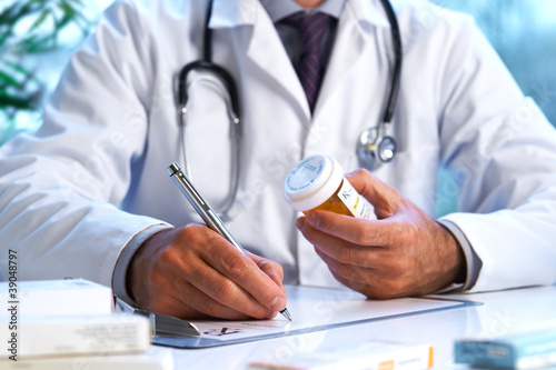 Doctor writing out RX prescription - 39048797