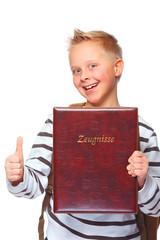 schoolboy proud of his school certificate