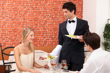 Couple being served their meal