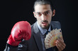 Man with boxing gloves and money