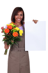 Gardener with flowers and poster