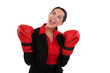 Smiling businesswoman wearing boxing gloves
